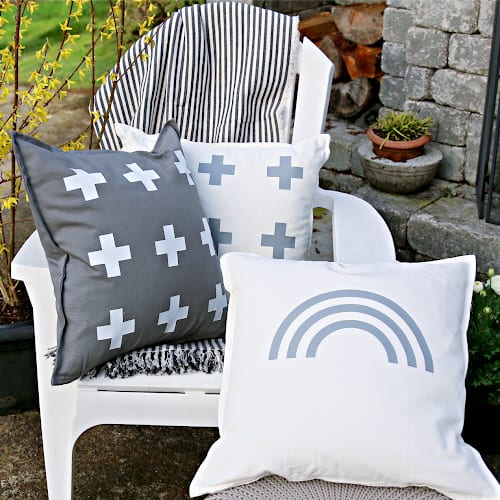 White chair with 3 decorative pillows for DIY Patio Ideas on a budget