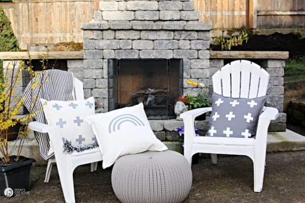 White outdoor chairs with decorative pillows in grey and white