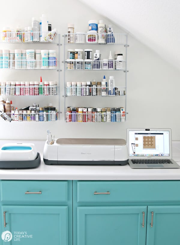 Craft Room with Turquoise cabinets with a Cricut Maker