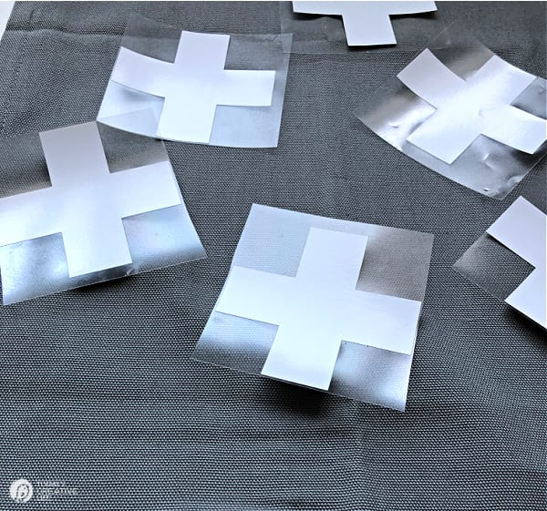 Swiss Cross Designs cut out to be ironed on a pillow