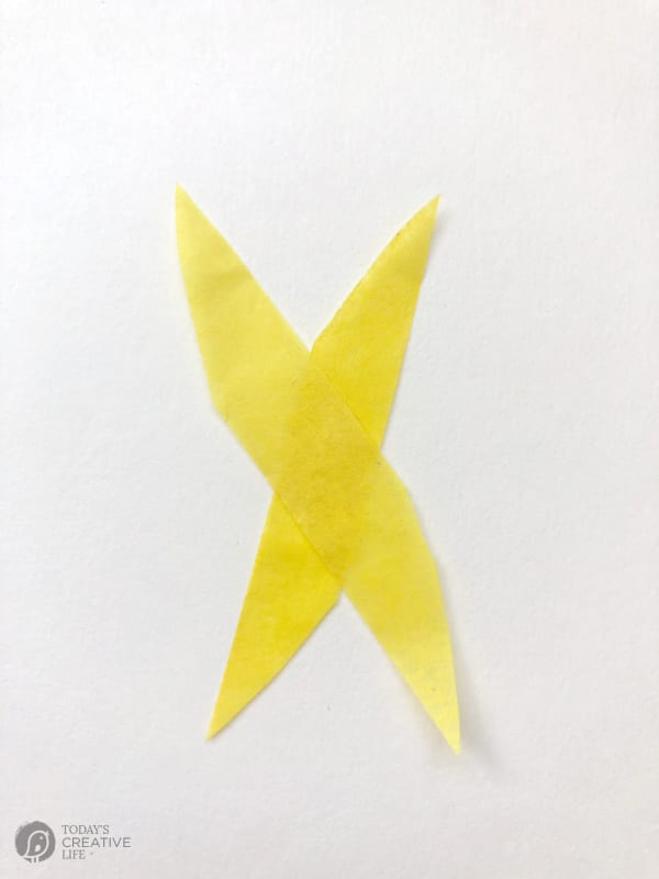 Tissue paper strips crossed into an X