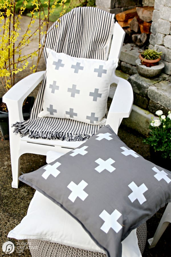 White Chair with White pillow and striped throw. Cricut Maker Iron-on Craft