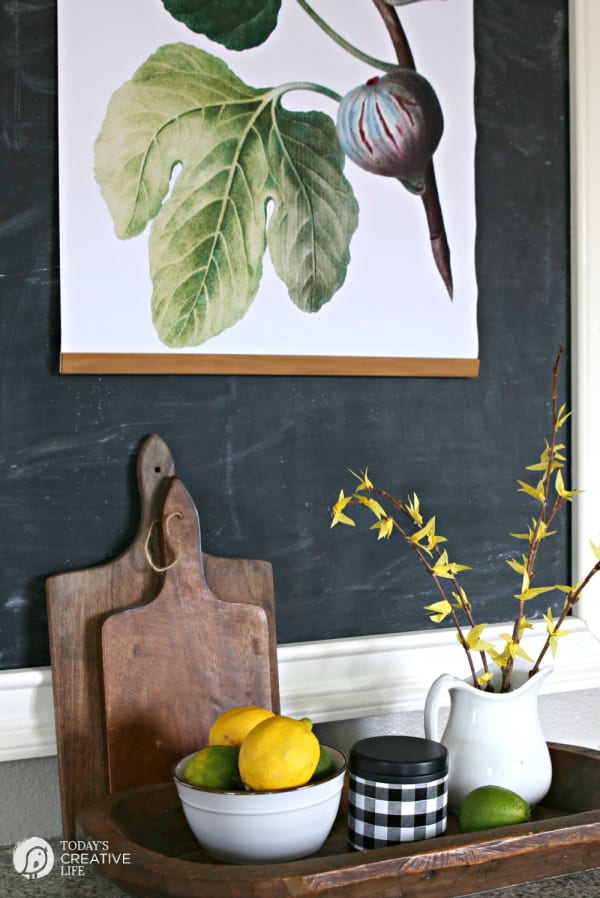 Spring decor in a kitchen with lemons and a bouquet of diy faux forsythia branches