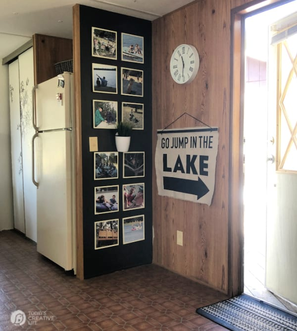 DIY for Wall Decor hanging on wall. Drop Cloth Canvas wall hanging that says Go Jump In the Lake.