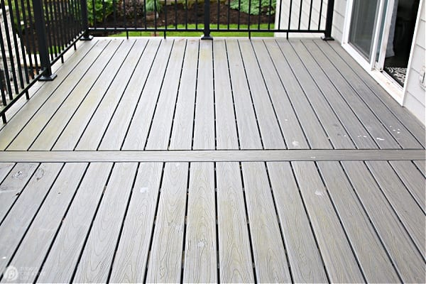 a composite deck with green moss build up.