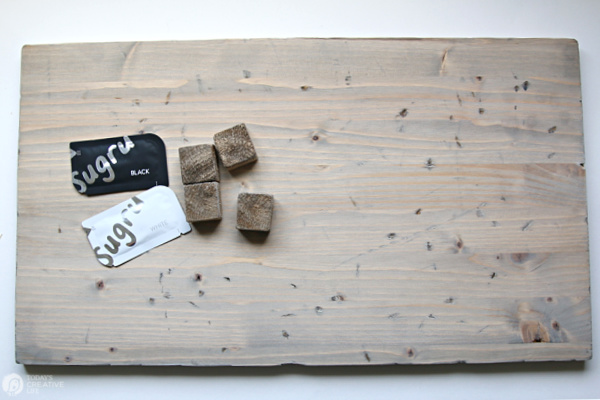Stained wood board and wood cubes for making a diy rustic tray.