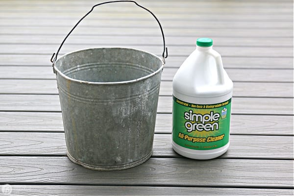 Tin Bucket and a Gallon of Simple Green Cleaner on a deck