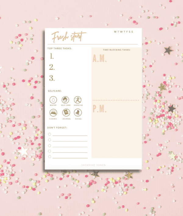 Daily planner notepad on a pink sparkle background